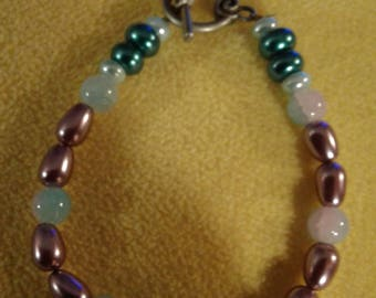 Bracelet with various bead colors.
