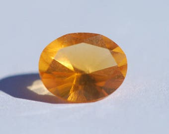 Mexican Jelly Opal, Flawed - Extremely Rare Faceted , Yellow Orange, Oval 7.3 x 9.1 mm, 1.3ct, F0304