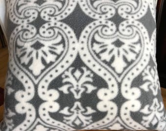 Gray and white flannel pillow