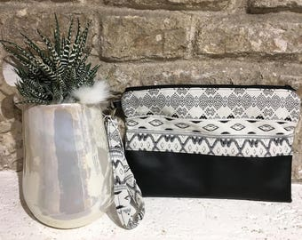 Faux leather clutch with black and white geometric texture