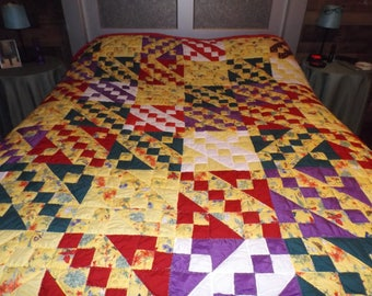 Homemade quilt pattern is Jacob's Ladder fits a full/queen size bed. Hand quilted.
