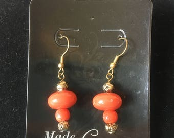 Rustic orange with gold colored rose accent beaded earrings.