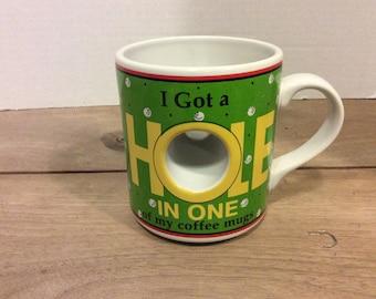 Ganz coffee mug,I got a  hole in one of my coffee mugs! Golf