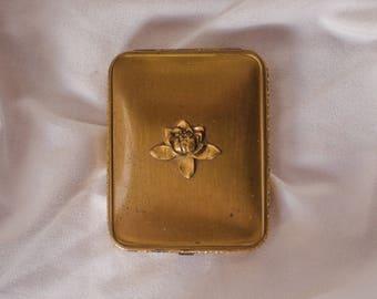 Vintage gold powder compact