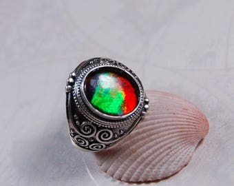 Ammolite ring.Gorgeous unisex design.Bright rainbow and in your size too.#080817