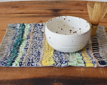 Woven mug rug, snack mat, placemat, table decoration. Hand woven. October Maximum Green Blue Yellow