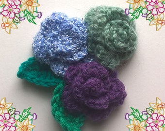 Adorable Crochet Brooch / Pin / Corsage. Trio of Roses and Leaves. Gentle Muted Tones of Mauve, blue, Green. Ooak Crochet Art.