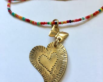 Brass heart in butterfly with long beaded necklace