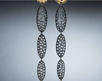 One of a kind earrings perforated silver and 22k gold