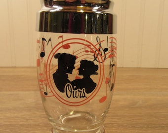 """Glass drink shaker with lid , spout and screw on cap-mid century- decorated with couple """"Ours"""" & musical symbols-nice condition"""