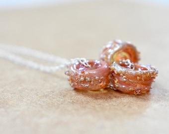 artisan glass beaded necklace. handmade glass beads on a chain. artisan bead trio necklace. artisan bead jewelry. minimalist bead necklace