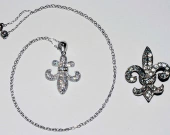 Vintage pot metal and rhinestone fleur de lis pin and sterling silver silver with clear rhinestone necklace shipping included U.S.A and Can