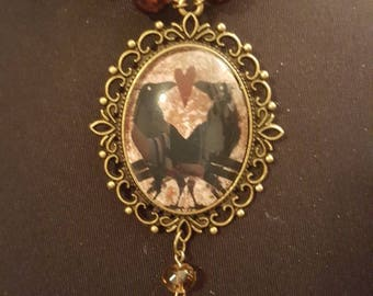crow raven glass cameo necklace