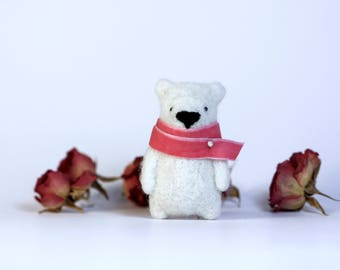 White bear brooch whit a pink scarf