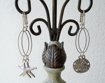 Set of 2 - Dangle Silvertone with charms - Sanddollar and Starfish - Elongated Hoops - One of a Kind - bycat