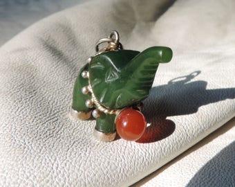 jade elephant gold details carnelian ball serpentine
