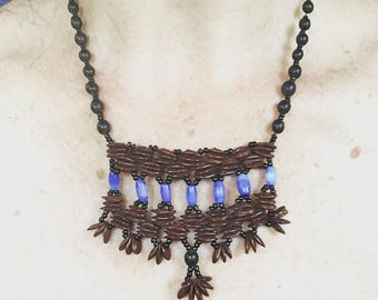 Nature Inspired Appleseed and Periwinkle Glass Bead Necklace.