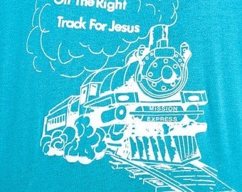 "40% OFF The ""On The Right Track For Jesus"" Teal TShirt"