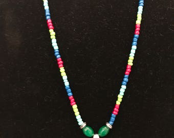 24 inch necklace, calypso colored beads, with tassel and tree of life charm
