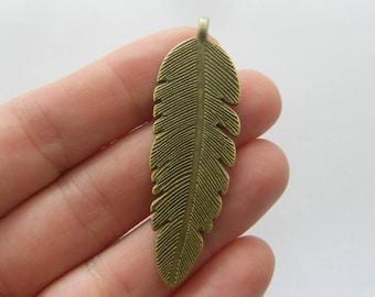 4 Feather pendants antique bronze tone BC299