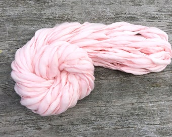 Handspun pale pink thick and thin yarn, spun super bulky - 50 yards, 3 ounces/ 85 grams