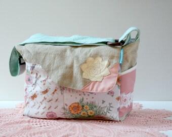 eco-friendly diaper bag,messenger bag, nappy bag, salvaged fabrics,leather succulent flower design, linen, vintage fabrics, pink,lace,floral