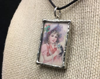 Soldered Glass Pendant with a quote about women and cats by Robert Heinlein and and antique Victorian art.