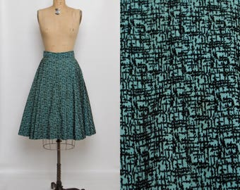 vintage 1940s turquoise and black skirt