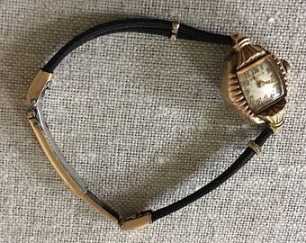 Antique Ladies Bulova Hadley Watch with a Black Cord Adjustable Band