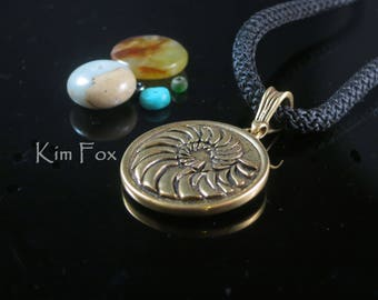 Ocean inspired Round reversible Nautilus and Scallop Pendant in Bronze designed by Kim Fox Suitable for men or women