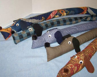 All kinds! Dachshund draft stopper; wind blocker; dog; energy saver; draught excluder;