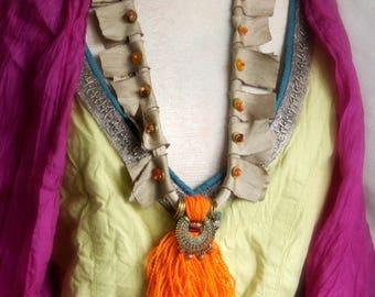 Handcrafted orange tassel  boho necklace.