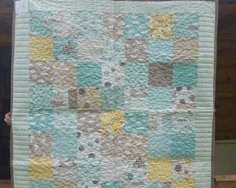 Beautiful neutral baby quilt pieced with fabric from Moda