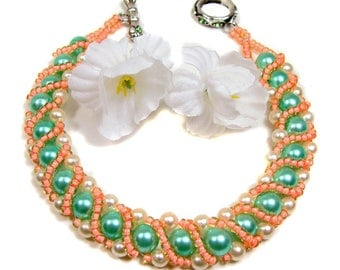 Handmade and Beaded Sherbet Green and White Pearl Bracelet with Coral Pink Accents