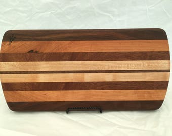 Cheese board made from walnut, mahogany, cherry and maple woods