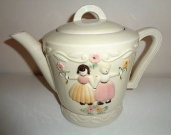 Vintage PORCELIER White Glazed Ceramic Teapot with delightful folk art style relief image of two girls holding hands in Near Mint Condition