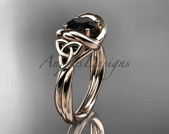 14kt rose gold trinity celtic twisted rope wedding ring with a Black Diamond center stone RPCT9146