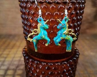 Turquoise rusty unicorn hand painted earrings