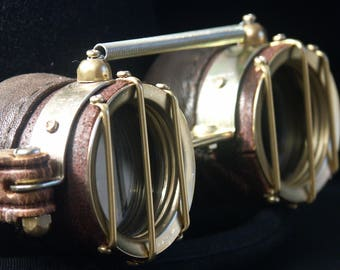 "Distressed steampunk goggles in brown leather and brass with ""protection bars"""