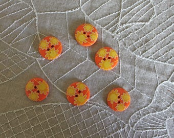 6 buttons orange plastic with yellow flowers