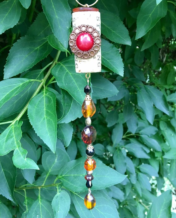 Items similar to repurposed wine cork ornament beaded sun Sun garden riesling