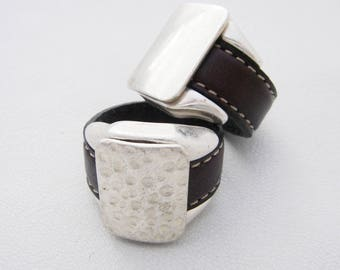 chocolate couture leather saddle on silver plated zamak base ring
