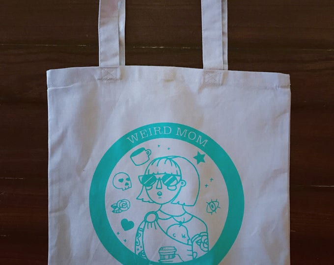 Lavender and turquoise cotton Tote Bag with Weird Mom Club design. 15x15 inches.