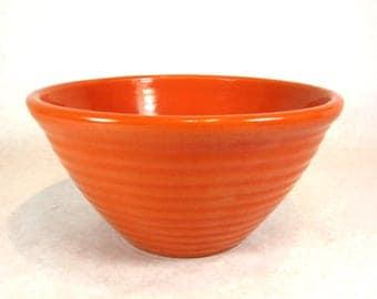 Bauer ringware orange bowl