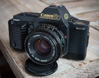 Working Vintage Canon T70 35mm Film SLR Camera with Canon Lens