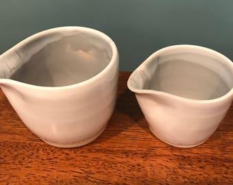 Set of two handmade ceramic nesting pouring bowls, nesting white creamers, sauce bowls