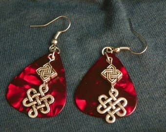 Silver Celtic charms paired with red guitar picks