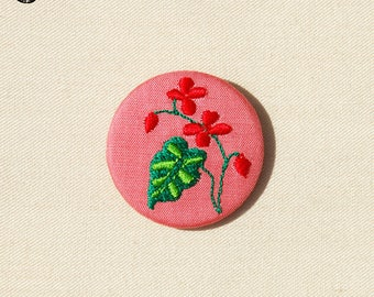 Small embroidered wood brooch
