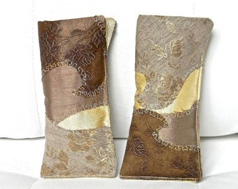 084 & 085 - quilted, brown glasses case is glossy, vanilla, chocolate.