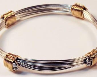 4 knot sterling silver bracelet with gold knots